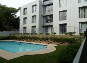 Newly built complex in morningside manor 2 bed 2 bath with a garden photo